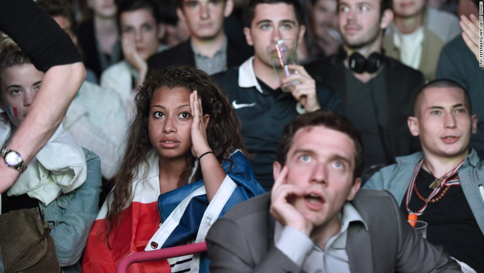 Spectators in Paris react as they watch the group-stage match between France and Ecuador on Wednesday, June 25. It ended 0-0.