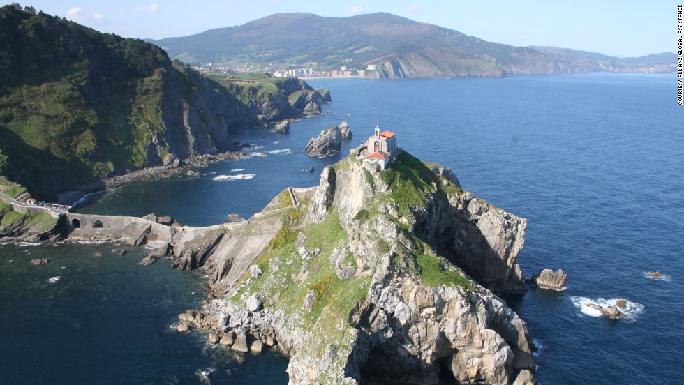 Gaztelugatxe, a small, rocky island on Spain's northern coast is said to resemble a castle, which could explain why it's suffered numerous attacks over the centuries. Connected to the mainland by a causeway, the island's main highlight is a chapel built in the 11th century in honor of St. John.