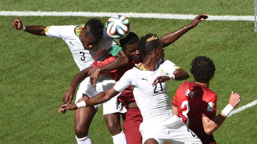 Gyan, left, Portugal midfielder William Carvalho, Ghana defender John Boye and Pepe vie for the ball during the match between Portugal and Ghana.