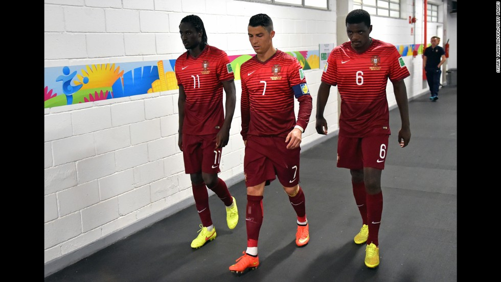 Eder, left, Ronaldo and William Carvalho of Portugal walk in the tunnel during halftime of the match between Portugal and Ghana.
