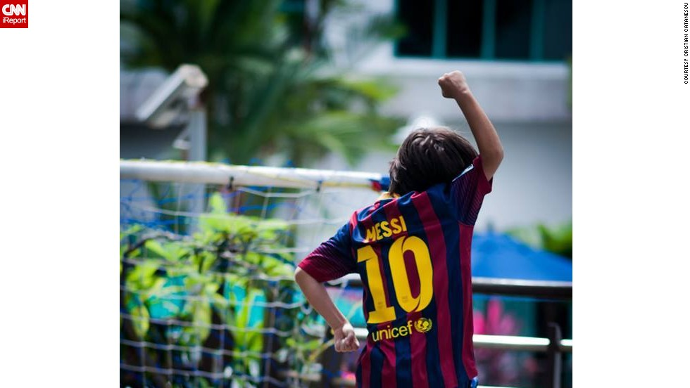 "Score! Cristian Catanescu's 9-year-old son celebrates after <a href=""http://ireport.cnn.com/docs/DOC-1143310"">getting a goal</a> on his family's terrace in Singapore. ""Football brings joy to this boy! He changed places and continents several times and his best way to connect to local people is through football,"" said Catanescu."