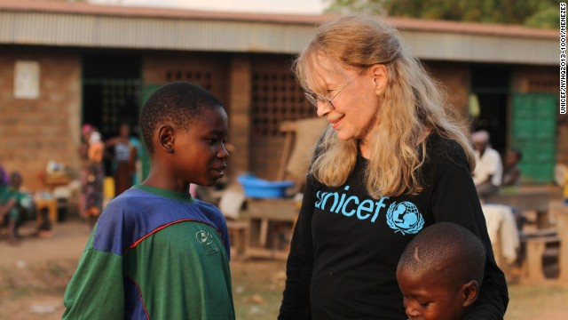 Mia Farrow meets brothers Oumarou and Adamou Bouba, 13 and 10, at the Bossangoa camp