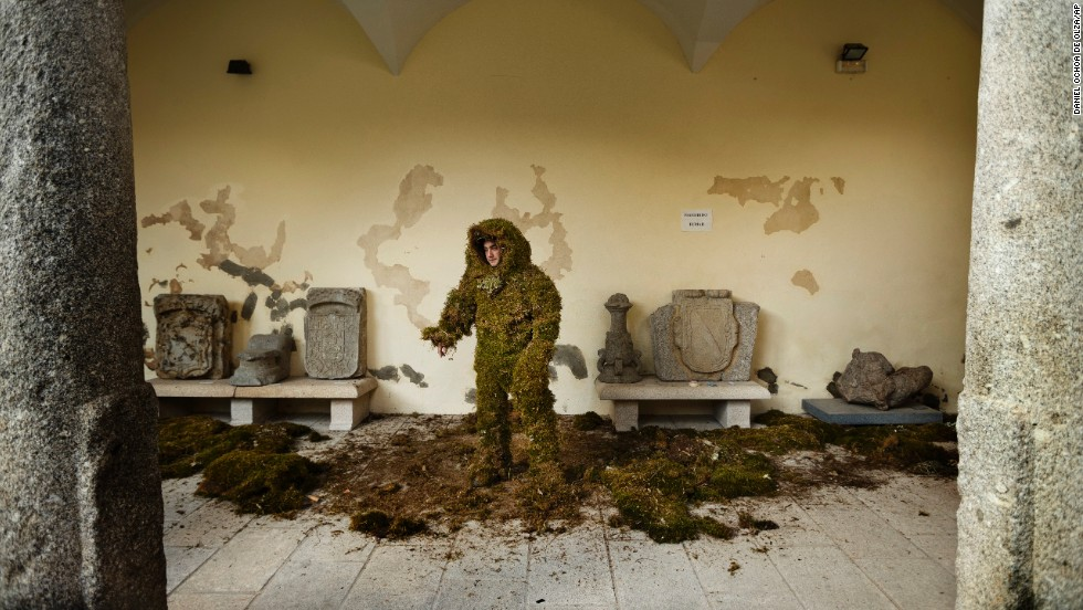 A man in a camouflage costume made of moss gets ready to take part in the Corpus Christi procession on Sunday, June 22, in the small village of Bejar, Spain. The tradition, which started in 1937, originates from a legend involving Christians covering their clothes and weapons with moss to get inside a Muslim fortress.