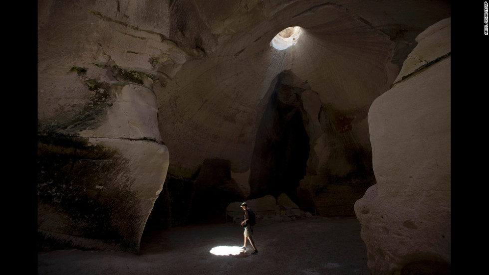 Saam Gabbay of the United States visits the man-made caves below the ancient cities of Maresha and Beit Guvrin in central Israel on Tuesday, June 24. The site was added to UNESCO's prestigious World Heritage List this week.