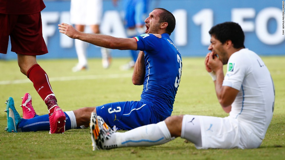Uruguay's Luis Suarez, right, reacts after clashing with Italy's Giorgio Chiellini during a World Cup match in Natal, Brazil, on Tuesday, June 24. Suarez was banned for four months after being accused of biting Chiellini.