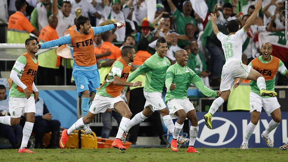 Algerian squad members celebrate after tying Russia 1-1 during a World Cup match at the Baixada Arena in Curitiba, Brazil, on June 26.