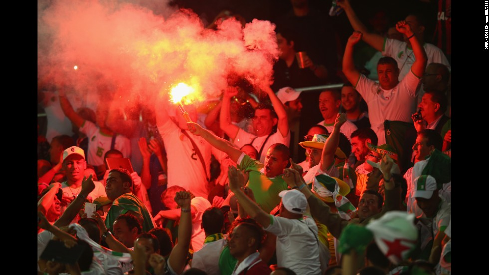 Algeria fans celebrate their team's first goal.