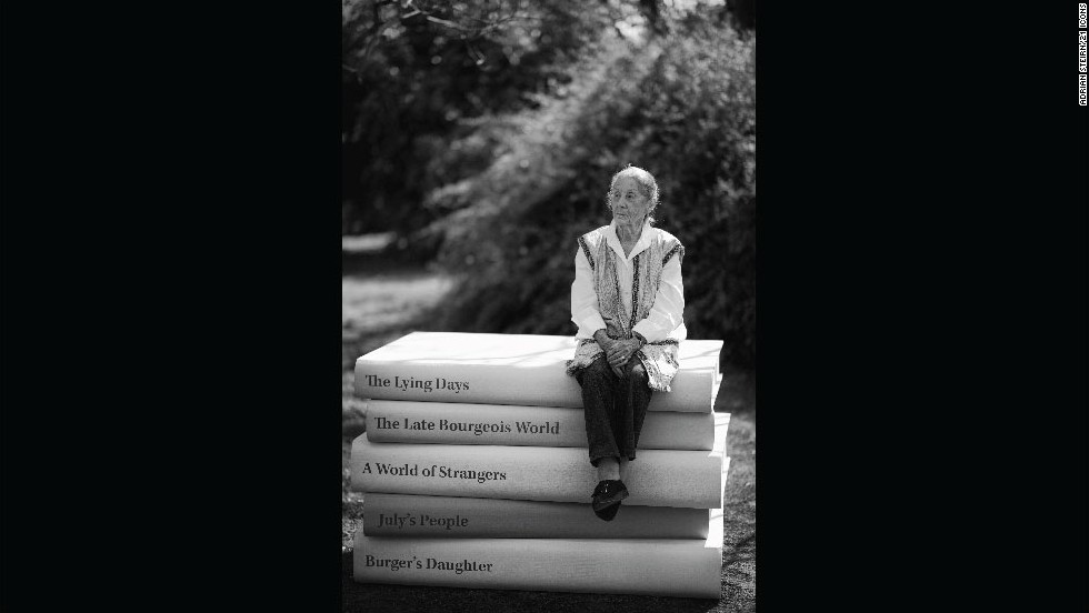 """<strong>Nadine Gordimer</strong><br /><br />Described as """"South Africa's grande dame of literature,"""" Nadine Gordimer was a pioneering literary figure for the nation. The 1991 <a href=""""/2014/07/14/world/africa/obit-nadine-gordimer/"""" target=""""_blank"""">Nobel Prize in Literature-winner, who died Sunday aged 90, is best-known for her works</a>, """"A Guest of Honour"""" (1970), the Booker Prize-winning """"The Conservationist"""" (1974) and """"July's People"""" (1981).   <br /><br />In addition to her literary achievements, Gordimer leaves behind a legacy of activism as she tirelessly fought to highlight the plight faced by those subjected to the segregated system of white rule. Recalling the November 2011 shoot which took place at Gordimer's home in Parktown, Johannesburg, Steirn remembers the strong willed author fondly.<br /><br />""""She's highly intelligent and she's got no time to waste. She'll tell you she doesn't like having her photo taken. And that is honestly the most extraordinary photograph taken of her.<br /><br />""""She came out of and said my work is bigger than me, so we decided to play with that,"""" he says. <br /><br />With this in mind, the 21 ICONS team had enormous versions of her most prolific titles -- works that were banned in the country during the apartheid years -- built in Cape Town and flown up to her house. The result is a demure but authoritative portrait of a women who always wanted her work to speak for her. <br /><br />Steirn adds: """"It looks like Alice in Wonderland and she's a tiny little thing but she is very formidable. There's a woman with power."""""""