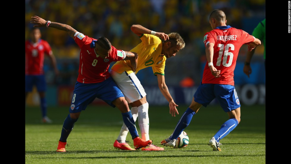 Arturo Vidal of Chile, left, battles for the ball with Neymar of Brazil.