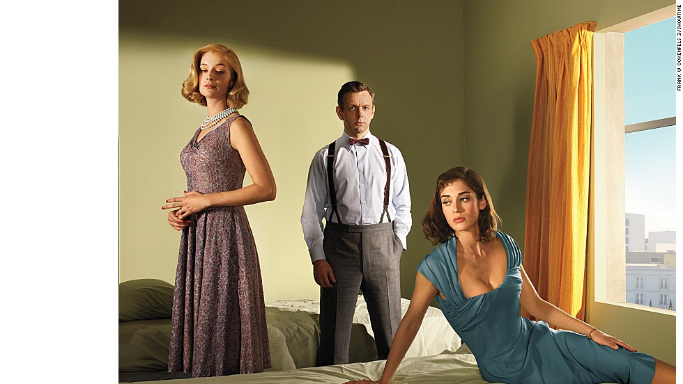 "Science is sexy on Showtime's ""Masters of Sex,"" which is based on real events. Research by Dr. William Masters (Michael Sheen) and Virginia Johnson (Lizzy Caplan) sets off the sexual revolution of the 1960s as they delve into the science behind human sexuality. Also starring: Caitlin FitzGerald as Libby Masters, left."
