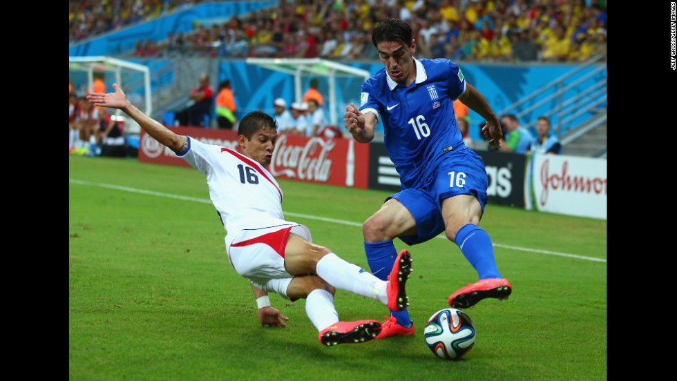 Cristian Gamboa of Costa Rica tackles Lazaros Christodoulopoulos of Greece.