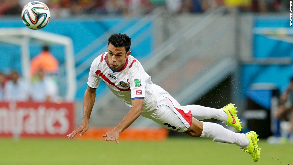 Costa Rica's Giancarlo Gonzalez heads the ball to a teammate.