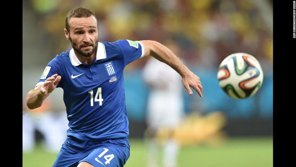 Greece's Dimitris Salpingidis eyes the ball.