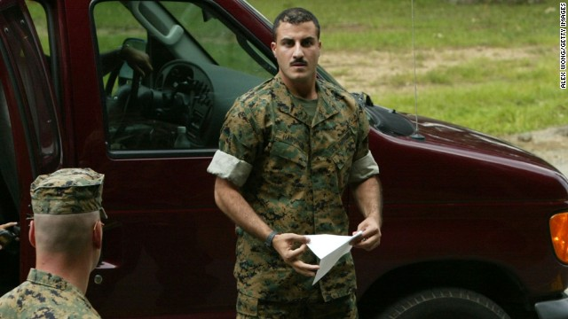 Caption:QUANTICO, VA - JULY 19: U.S. Marine Corporal Wassef Ali Hassoun (R), who went missing in Iraq and turned up safe in Lebanon three weeks later, prepares to read a statement to the media July 19, 2004 outside the U.S. Marine Corps Base in Quantico, Virginia. Hassoun said he was captured and held against his will by anti-coalition forces for 19 days. (Photo by Alex Wong/Getty Images)