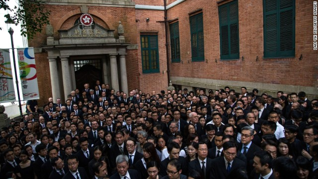 Hundreds of representatives from the legal sector take part in a silent march in Hong Kong, calling on Beijing to withdraw parts of the State Council's White Paper.