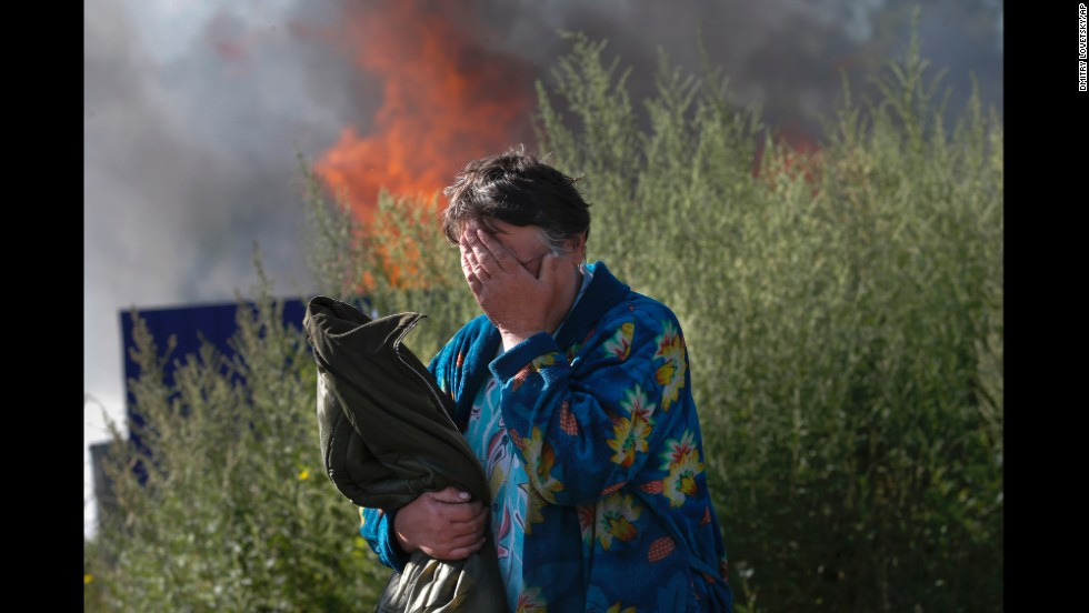 A woman cries as her house burns after a bombing in Slovyansk on Monday, June 30.