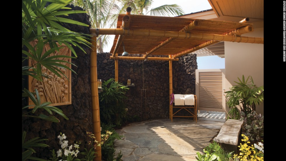 This Four Seasons Resort Hualalai on Hawaii's Big Island features outdoor showers for guests in its first-floor rooms in the two-story bungalows.