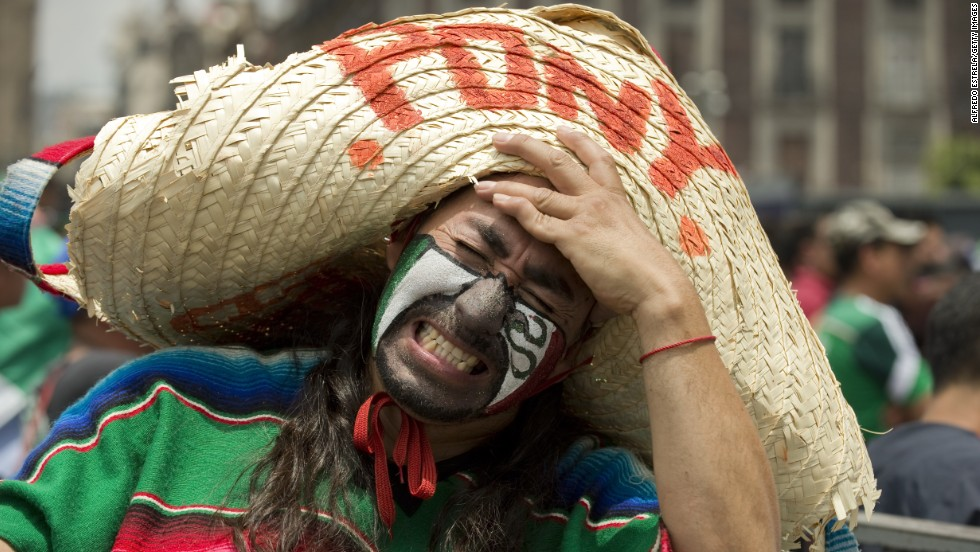 A Mexico fan shows his dejection at Zocalo Square in Mexico City after the national team lost to the Netherlands 2-1 in a round-of-16 match Sunday, June 29.