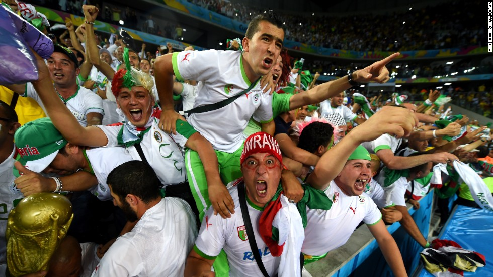 Algeria fans in Curitiba, Brazil, celebrate after a 1-1 draw with Russia on Thursday, June 26, put their team through to the next round of the World Cup.