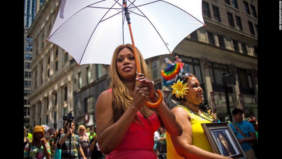 "Grand Marshal Laverne Cox, left, and Delores Nettles, mother of <a href=""http://www.cnn.com/2013/08/24/us/new-york-transgender-woman-death/"">slain transgender woman Islan Nettles</a>, march in the parade."