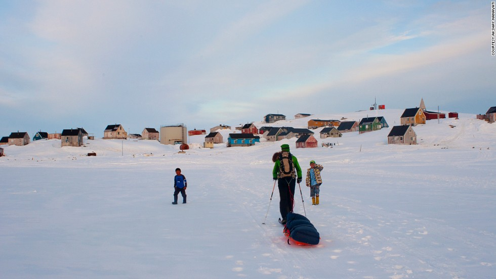 "He completed the one-month trek across Greenland ""in a tiny hunting village on the east coast ... where there are more dogs than people. I was greeted by two Inuit boys who wanted to drag my sled to the final house where we would take our first shower in a month."""
