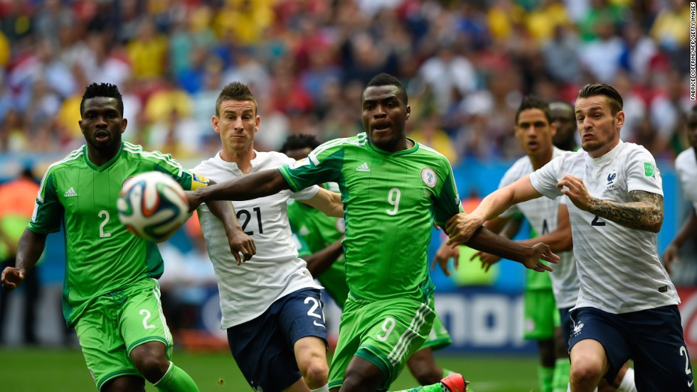 Yobo, left, and Nigerian forward Emmanuel Emenike, third left, chase after the ball near French defenders Koscielny, second left, and Mathieu Debuchy, far right.