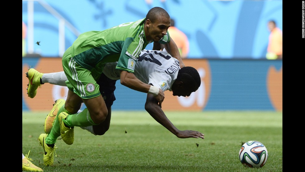 Nigerian forward Peter Odemwingie, left, challenges Blaise Matuidi of France.