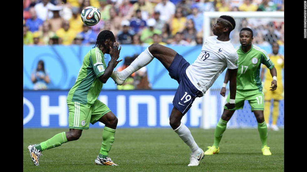 Pogba reaches for the ball near Nigeria's Victor Moses.