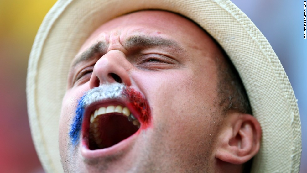 "A France fan cheers before the game. <a href=""http://www.cnn.com/2014/06/29/football/gallery/world-cup-0629/index.html"">See the best World Cup photos from June 29</a>"