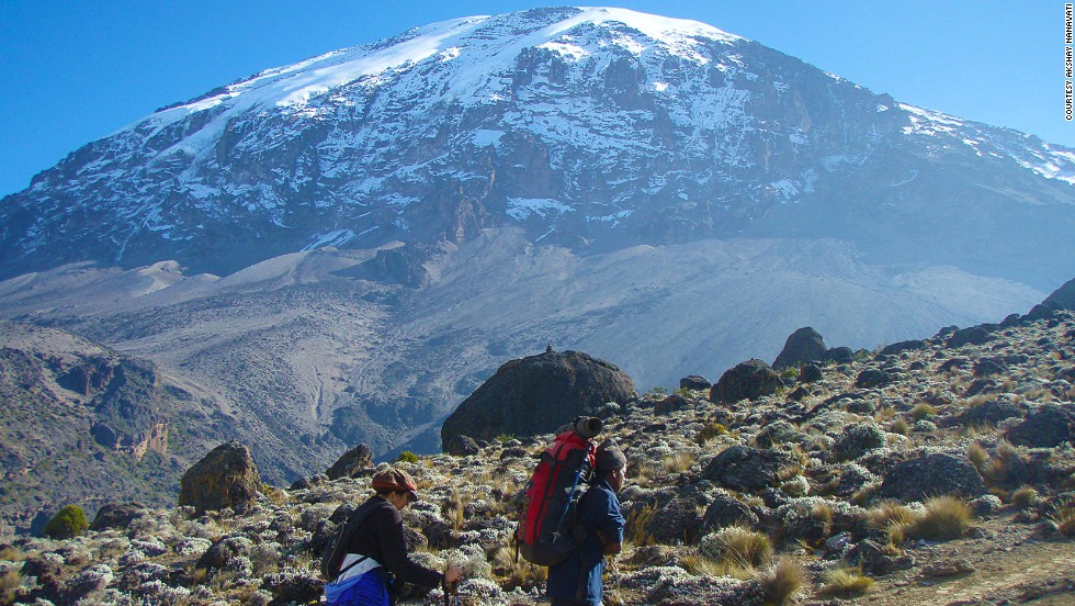 """I have always been an avid traveler as well, so it occurred to me that there would be no better way to see the planet and the people that live within it than by doing so on foot."" Here Nanavati's hiking up Mount Kilimanjaro in Tanzania."