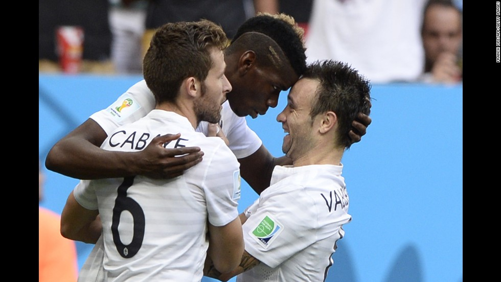 From left, French midfielders Yohan Cabaye, Paul Pogba and Mathieu Valbuena celebrate after Pogba's second-half goal opened the scoring.