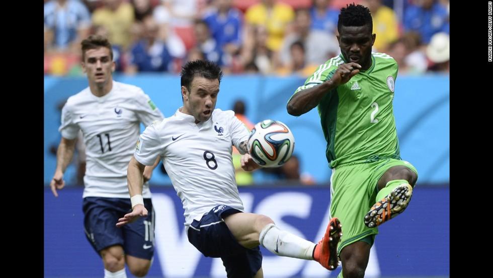 Yobo challenges Valbuena.