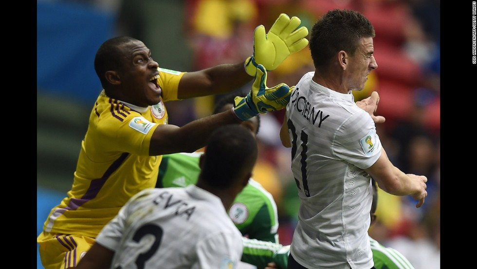 Koscielny and Enyeama compete for the ball.