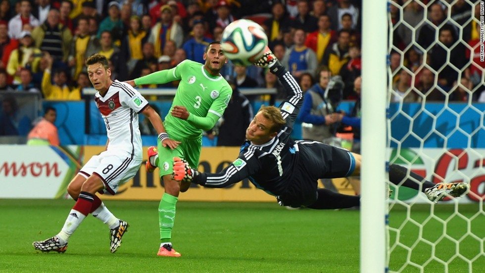 Algeria's Faouzi Ghoulam, center, attempts a shot on goal.