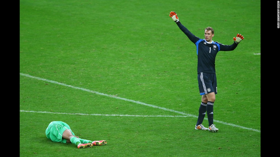 Islam Slimani of Algeria lies on the pitch next to goalkeeper Manuel Neuer of Germany during a World Cup match Monday, June 30, in Porto Alegre, Brazil. Although Algeria had a late goal, Germany still advanced to the quarterfinals with a 2-1 victory.