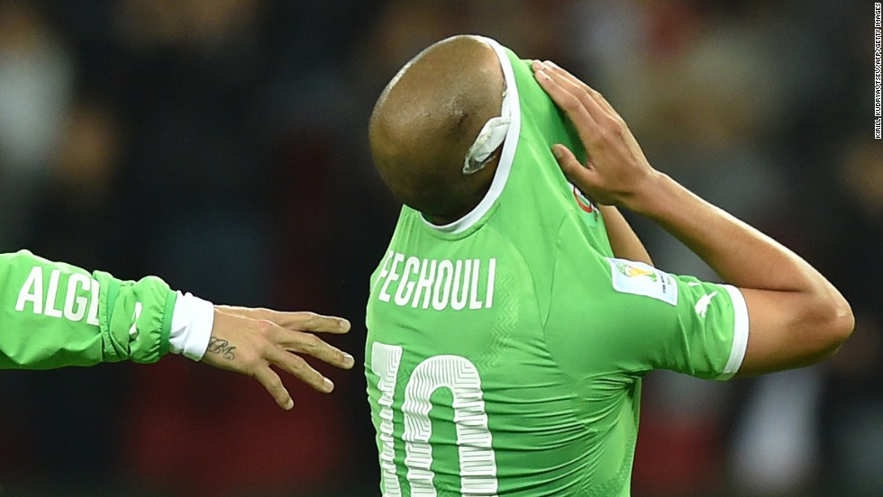 Algeria's Sofiane Feghouli reacts after losing against Germany.