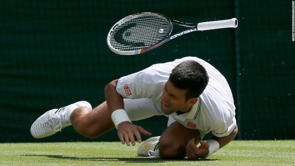 Novak Djokovic falls during his Wimbledon match against Gilles Simon on Friday, June 27, in London. Djokovic hurt his shoulder but went on to beat Simon in straight sets and advance to the fourth round of the tournament.