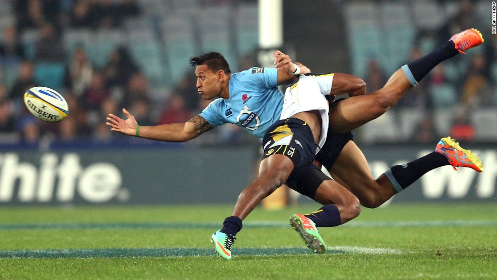 Israel Folau of the New South Wales Waratahs, left, is tackled by the Brumbies' Tevita Kuridrani during a Super Rugby match in Sydney on Saturday, June 28.