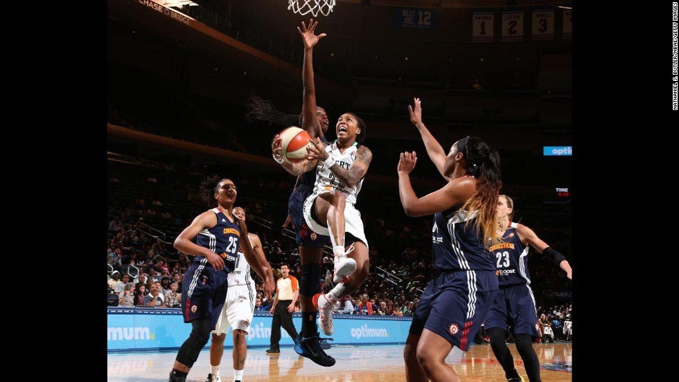 Cappie Pondexter of the New York Liberty drives the lane for a shot during a WNBA game against the Connecticut Sun on Sunday, June 29, in New York.