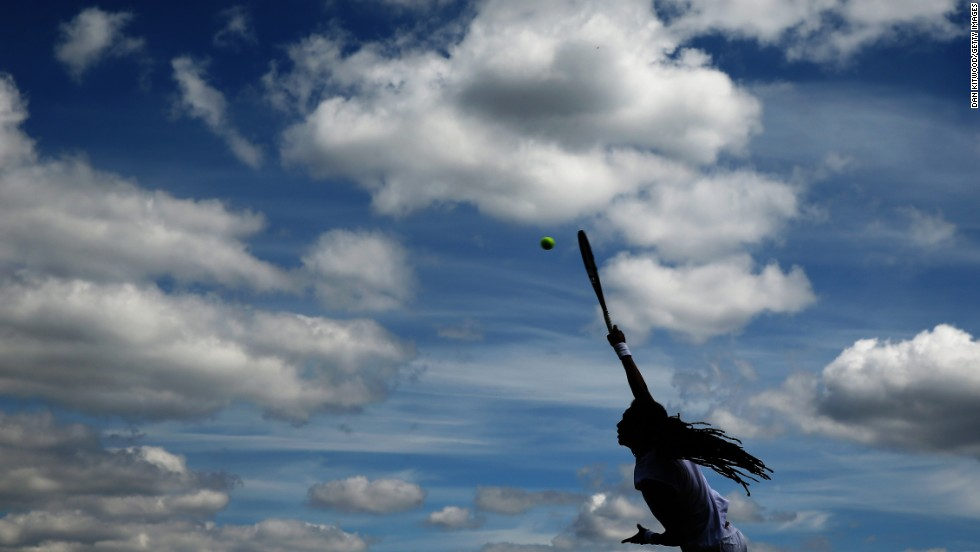 "Dustin Brown serves the ball during a doubles match at Wimbledon on Wednesday, June 25. Brown and Jan-Lennard Struff won their first-round match against Ken and Neal Skupski. <a href=""http://www.cnn.com/2014/06/24/worldsport/gallery/what-a-shot-0624/index.html"">See 38 amazing sports photos from last week</a>"