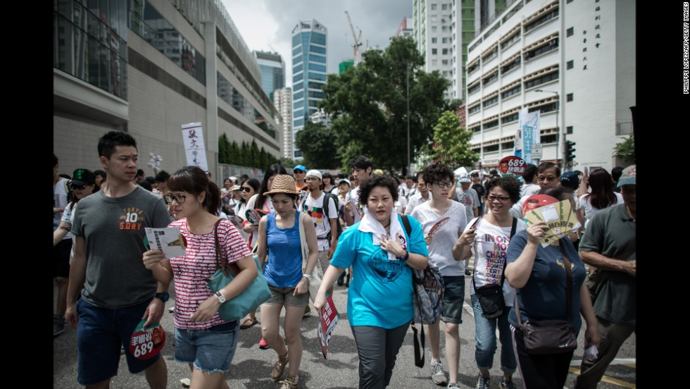 Demonstrators walked through downtown Hong Kong.