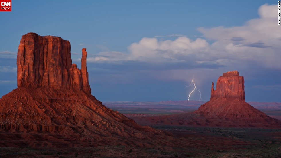 "Monument Valley on the Arizona-Utah line is known for its sandstone formations and vast desert views.<a href=""http://ireport.cnn.com/docs/DOC-1145480""> Toby Dingle</a> photographed lightning striking, ""an amazing thing to witness,"" last September."