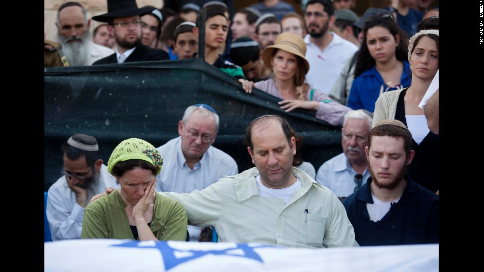 Avi and Rachel Frankel attend the funeral of their son, Naftali, in the West Bank settlement of Nof Ayalon on July 1. He was 16.
