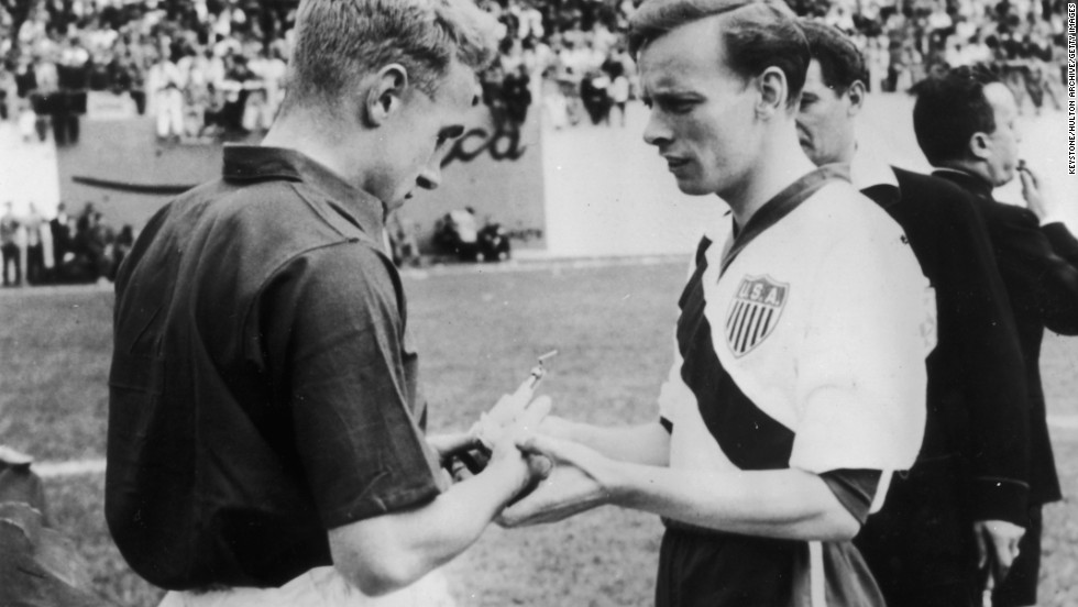 The American and English captains, Ed McIlvenny and Billy Wright exchange souvenirs prior to their game at the Brazil World Cup in 1950. Their first success at the World Cup came in this game with a surprise 1-0 victory over England. USA fans will be hoping for the same success at this year's World Cup finals.