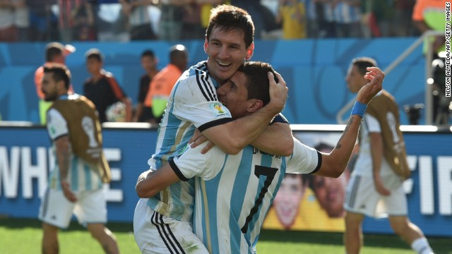 Argentina's forward and captain Lionel Messi (L) and Argentina's midfielder Angel Di Maria celebrate after scoring the 1-0 during a Round of 16 football match between Argentina and Switzerland at Corinthians Arena in Sao Paulo during the 2014 FIFA World Cup on July 1, 2014. AFP PHOTO / NELSON ALMEIDA (Photo credit should read NELSON ALMEIDA/AFP/Getty Images)