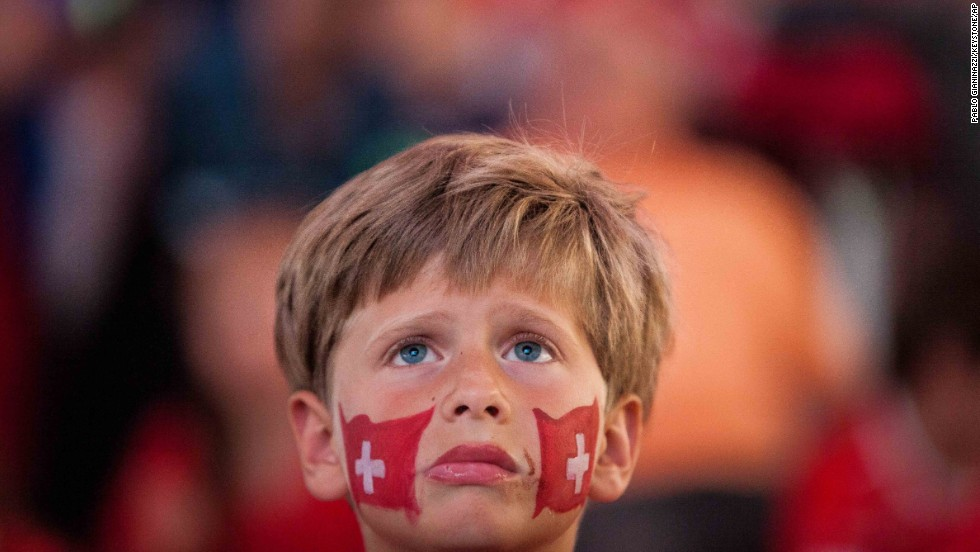 A young soccer fan in Lugano, Switzerland, watches a television screen during the live broadcast of the Switzerland-Argentina World Cup match on July 1.