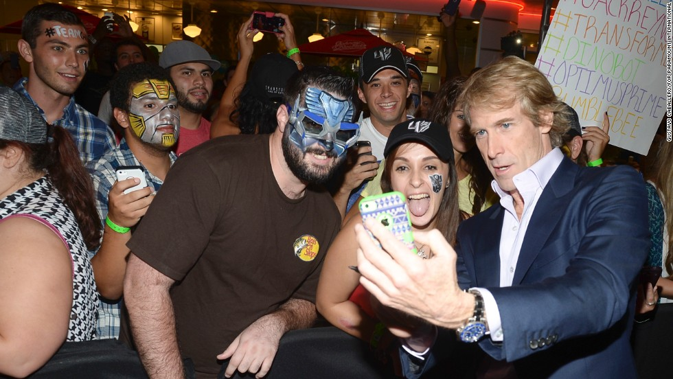 "Director Michael Bay poses for a selfie with fans in Miami before a screening of his new movie, ""Transformers: Age of Extinction,"" on Thursday, June 26."