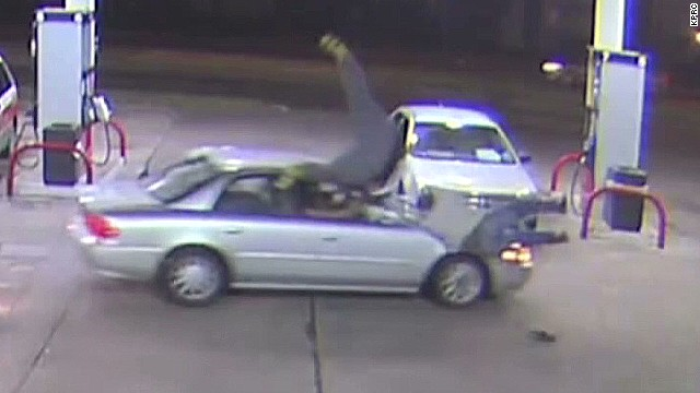 pkg woman runs over two men gas station_00005804.jpg
