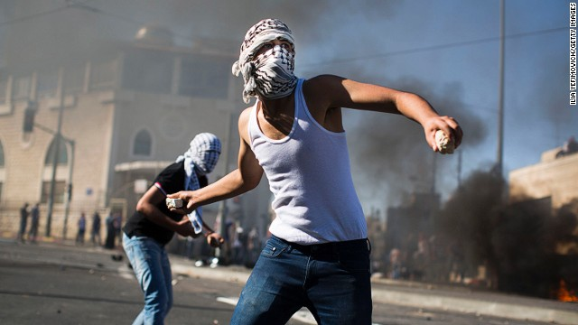 Palestinian youths clash with Israeli police in Jerusalem on July 2.