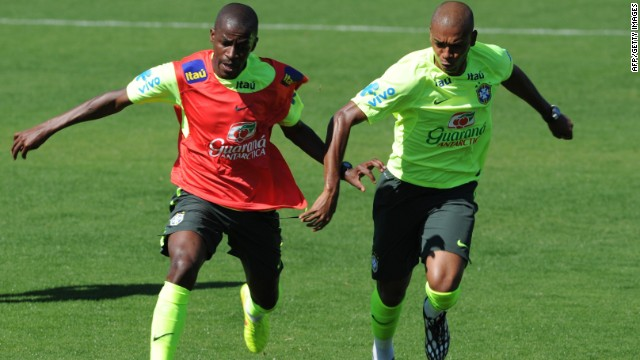 Brazil's Ramires (L) and Fernandinho during a training session for the World Cup 2014 in Teresopolis, Rio de Janeiro state, Brazil on July 2, 2014